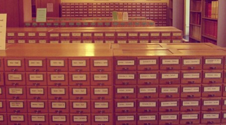Several rows of old school card catalogues at a library