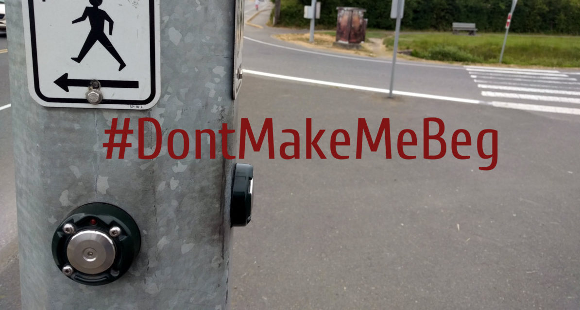 Image of push button to activate crossing signal with hashtag Don't Make Me Beg