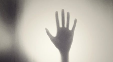 Black and white silhouette of a hand