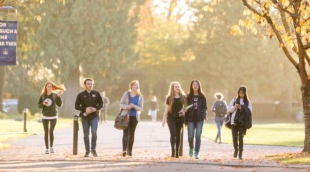 Trinity Western University students walk on campus