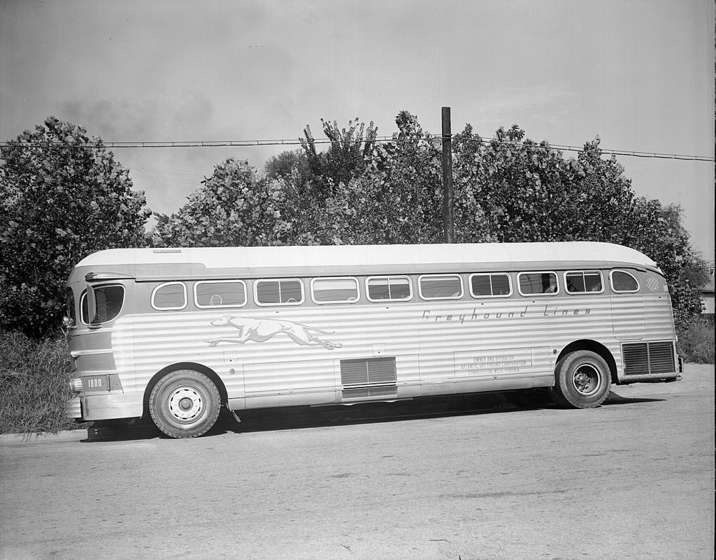 black and white image of a greyhound bus