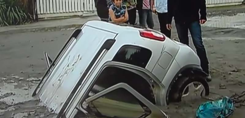 A car sinks due to liquefaction, in New Zealand in 2011.
